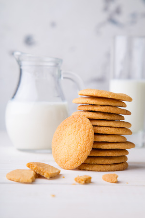 Shortbread kamut cookies with glass and jug of milk Stock Photo