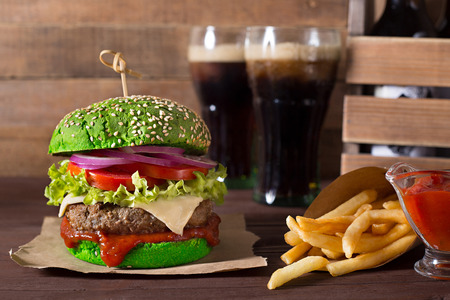 vegetarian hamburger: Green beef burger with french fries potato and cola on wood background