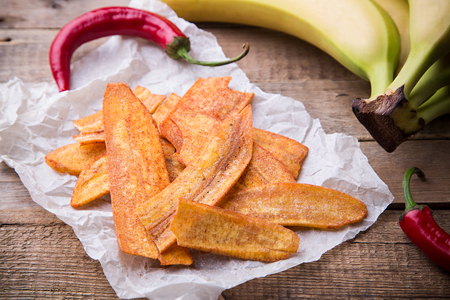 Fried thinly sliced banana chips with chili pepper, Mexican fast food Stock Photo