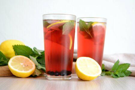 Berry lemonade or sangria in glasses Summer refreshing drink