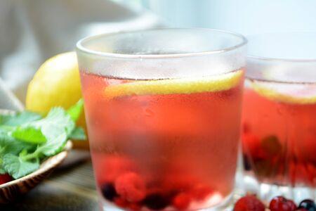 Cold berry lemonade in glasses Summer refreshing drink
