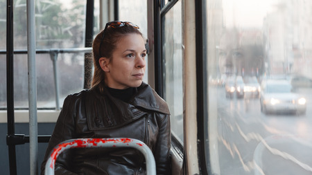 Woman riding in a bus Stock Photo