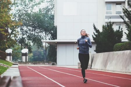 Young woman jogging on a cold day