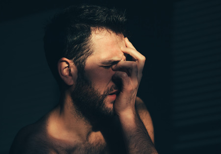 Young man sad and crying Stock Photo