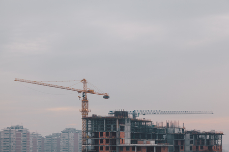 Apartment building under construction on a cold cloudy day