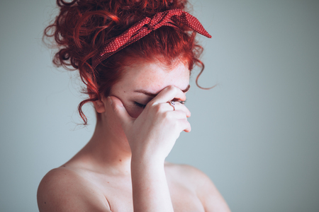 Portrait of beautiful young woman feeling emotional