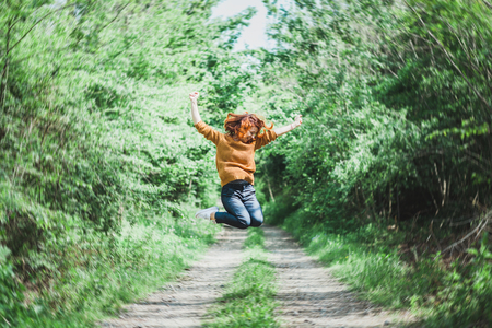 Young cheerful woman in mid air