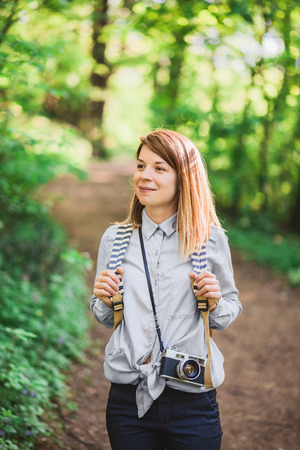 Young female photographer in the forest