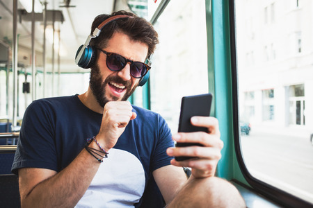 Young man listening to the music in public transport Archivio Fotografico