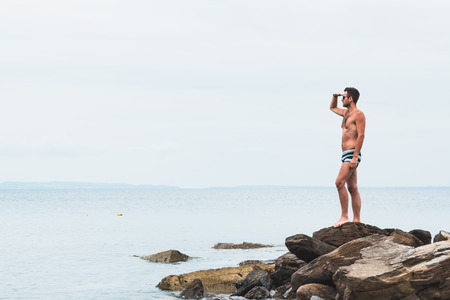 Young man enjoying the view by the sea Archivio Fotografico