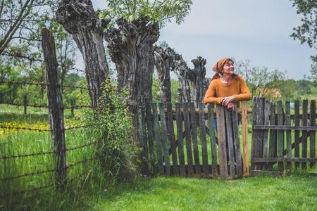 Peasant mature woman in yard