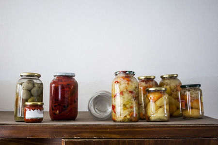 Food preserving for autumn winter time. Jars with pickled vegetables in cellar Archivio Fotografico