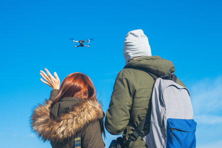 Two couple taking a selfie with a drone, drone navigating Stock Photo