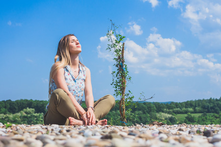 Young woman enjoying in the nature