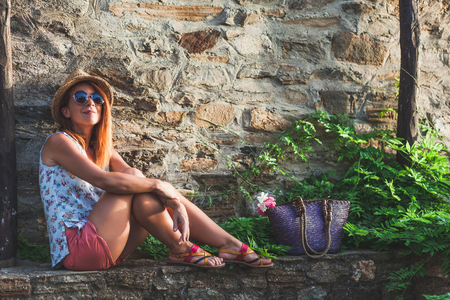 Young woman enjoying sunset at balcony