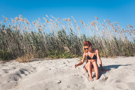 Young woman enjoying alone on the beach