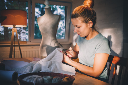 Professional dressmaker, designer making a costume at atelier. Fashion and tailoring concept