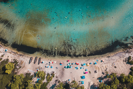 Aerial view of the tropical beach full of people