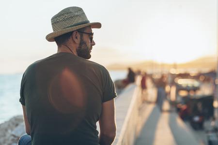 Man enjoying the sunset in the harbor