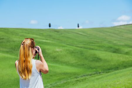 Young woman traveling through Tuscany, Italy Stock Photo