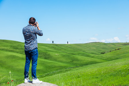 Young man traveling through Tuscany, Val d'Orcia