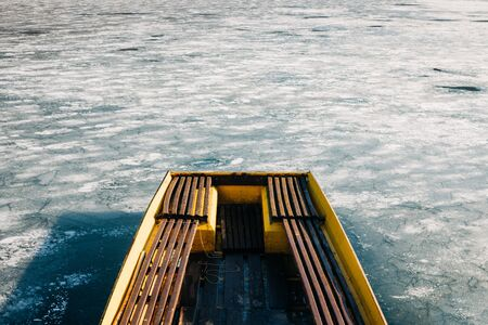 Boat in a frozen lake in winter time Stock Photo