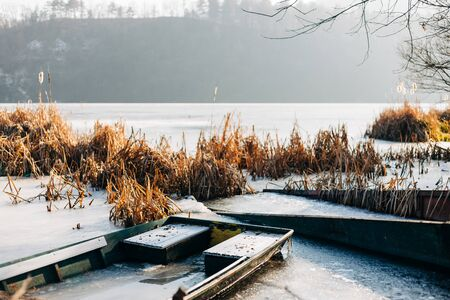 Boats in a frozen lake in winter time Stock Photo