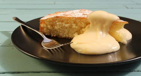 Lemon cake with lemon cream on black plate with fork Stock Photo - 20441337