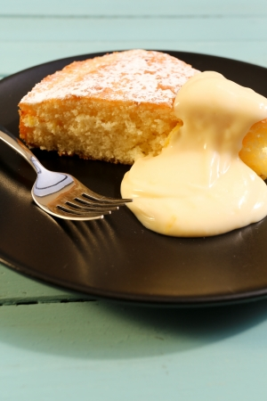 Lemon cake with lemon cream on black plate with fork Stock Photo - 20442111