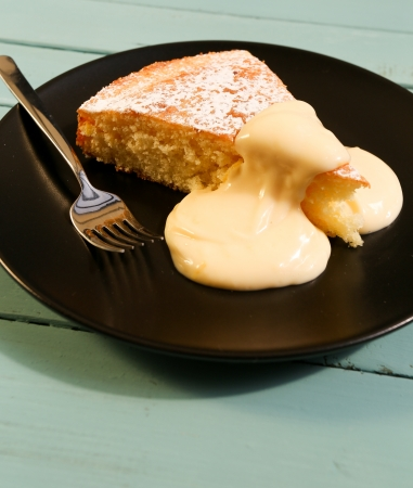 Lemon cake with lemon cream on black plate with fork Stock Photo - 20442105