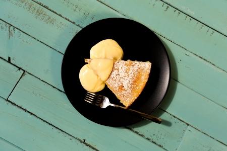 Lemon cake with lemon cream on black plate with fork Stock Photo - 20442132
