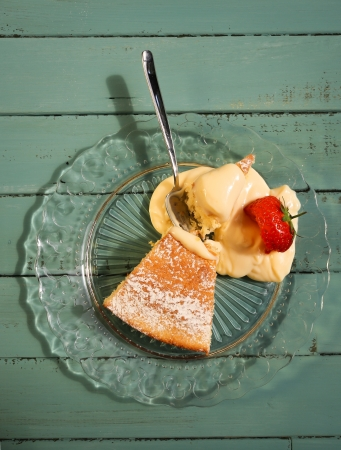 Lemon cake with lemon cream on glass plate with strawberry Stock Photo - 20442116