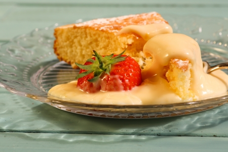 Lemon cake with lemon cream on glass plate with strawberry Stock Photo - 20441353