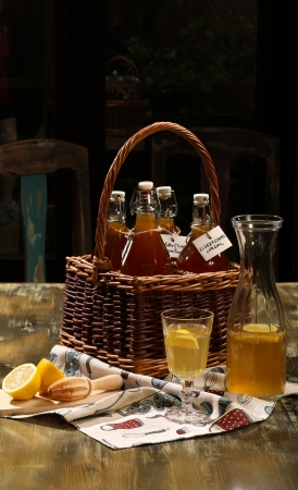 diluted: Elderflower cordial diluted with water and freshly served with lemon slices and lemon juice Stock Photo