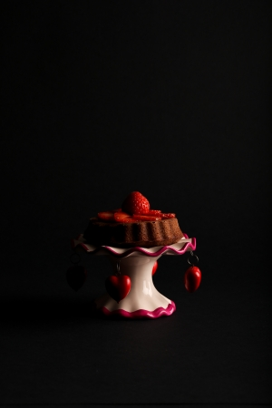 Vanilla Lemon Sponge Cake with strawberries on antic stand with red hearts on dark background Stock Photo - 20889868