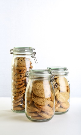 Chocolate, lavender and hazelnut cookies in a jar on white background Stock Photo