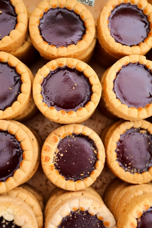 Raspberry Chocolate Tarts in a wooden box photo