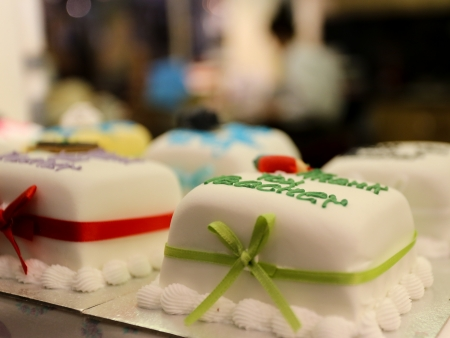 consumable: Marzipan covered decorated cake with ribbon and signs - consumable art