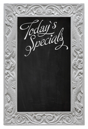 Elegant antique white picture frame with chalkboard used as Today`s Specials  Stock Photo