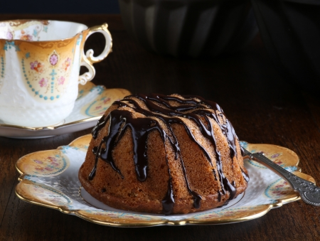 Mini Pound Cake - Hazelnut cake with chocolate drizzle with old pictures coffee cup and side plate