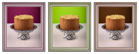 Chocolate birthday party cake with almond flakes on antique ceramic stand with blue pattern, purple, green and brown background, white canvas, group of isolated metallic frames Stock Photo