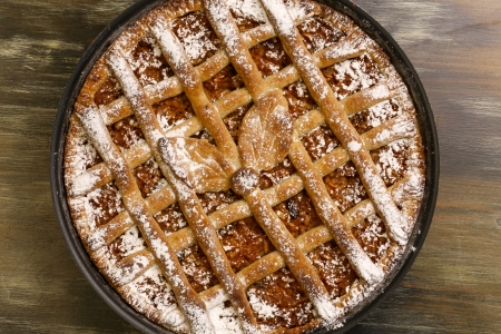 pealing: Apple pie in baking tray on rustic table Stock Photo