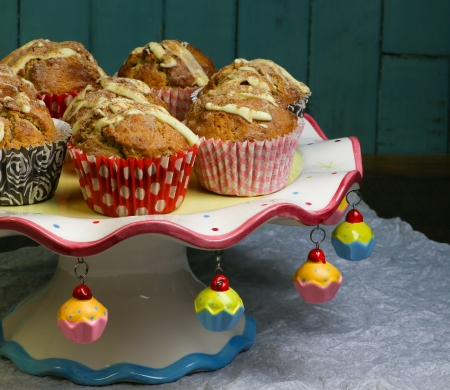 Banana Walnut muffins with white chocolate and cinnamon on colorful ceramic stand and rustic turquoise background photo