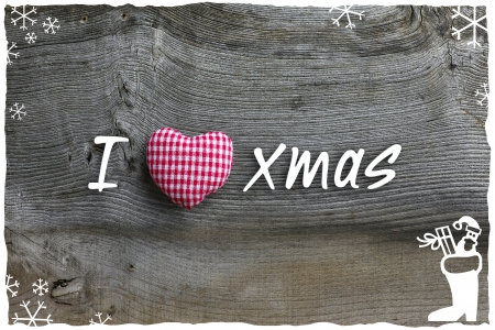 Christmas handmade decoration gingham fabric hearth over rustic Elm wood background - retro style design, copy space Stock Photo