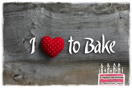 Love to bake message handmade decoration polka dot fabric hearth over rustic Elm wood background - retro style design photo