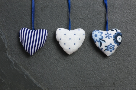 White Blue pattern Love Valentine s hearts hanging on grey slate stone background hanging on grey slate stone background photo