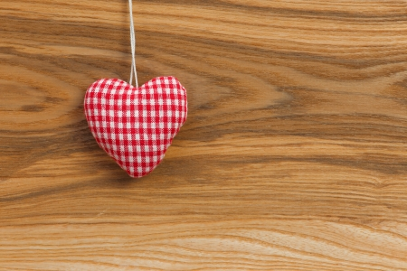Gingham Love Valentine s heart hanging on wooden texture background