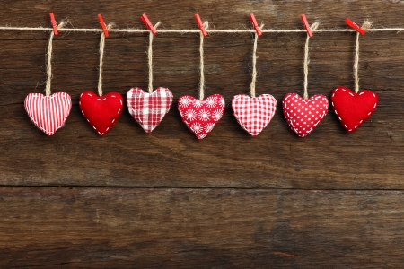Gingham Love Valentine s hearts hanging on wooden texture background