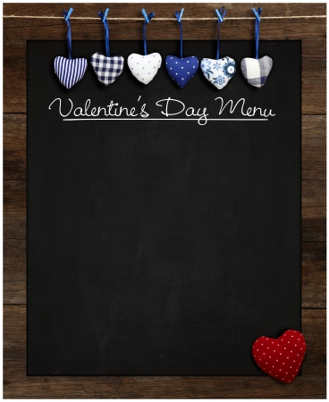 Valentine s Day Menu Chalkboard Blue and Red Gingham Love hearts hanging on wooden frame with blackboard Stock Photo