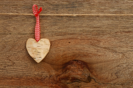 White Birch Love Valentine s heart hanging on wooden texture background photo